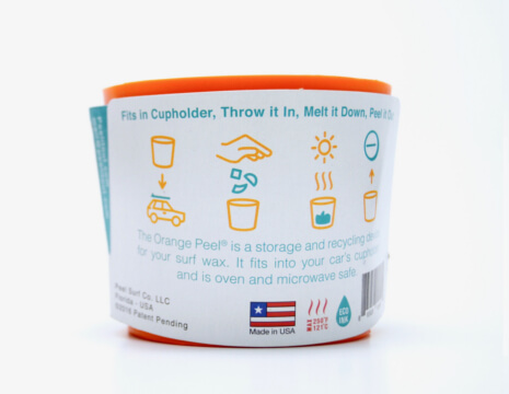 The Orange Peel is the perfect way to recycle your unused surf wax and is one of the examples of surf gear sold by Shark Tooth