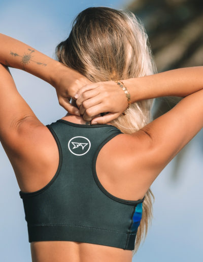 Barbara Brigido modeling the back view close up of the Namaste Sports Bra by Shark Tooth Surf Co. Photo by: Carson Grzegorczyk