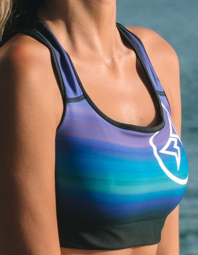 Barbara Brigido modeling the front view close up of the Namaste Sports Bra by Shark Tooth Surf Co. Photo by: Carson Grzegorczyk