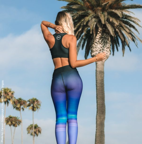 Barbara Brigido modeling the back view of the Namaste Yoga/Surf Leggings by Shark Tooth Surf Co. Photo by: Carson Grzegorczyk