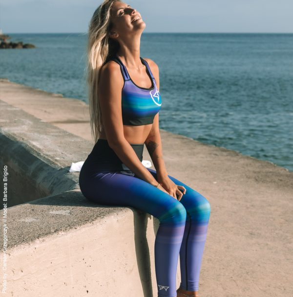 Barbara Brigido modeling the full side view of the Namaste Yoga/Surf Leggings by Shark Tooth Surf Co. Photo by: Carson Grzegorczyk
