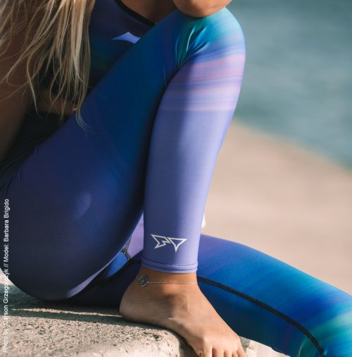 Barbara Brigido modeling the side view close up of the Namaste Yoga/Surf Leggings by Shark Tooth Surf Co. Photo by: Carson Grzegorczyk
